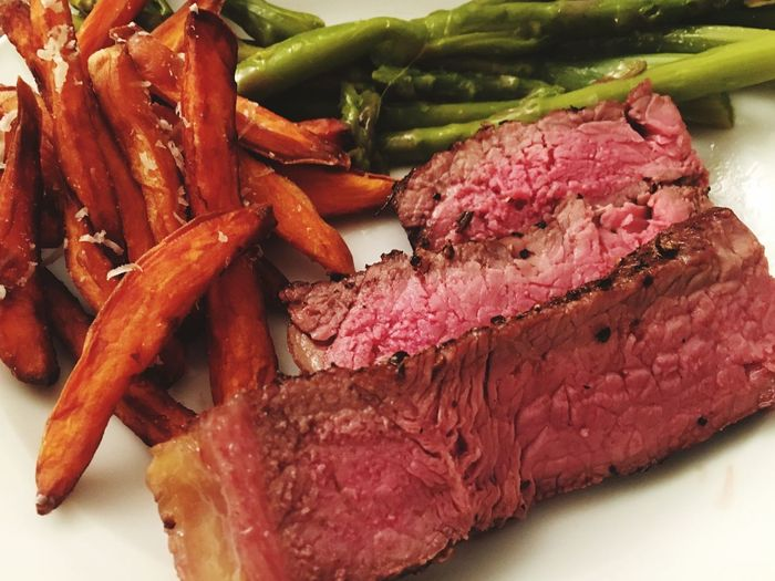 Dinner for two Plate Greens Sweet Patatoe Fries BLOODY Blood Dinner Medium Rare Red Meat Food Food And Drink Steak Beef Freshness Close-up Indoors  Ready-to-eat Healthy Eating Serving Size Raw Food No People SLICE