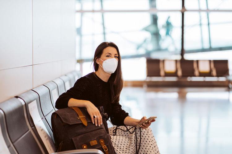 Young woman sitting at camera