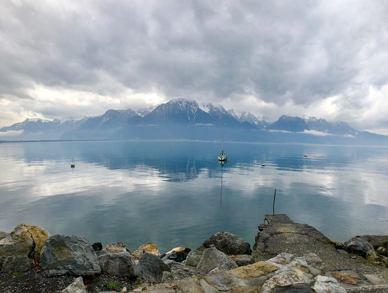 cloud - sky, water, mountain, sky, beauty in nature, scenics - nature, tranquility, tranquil scene, rock, rock - object, solid, nautical vessel, sea, nature, mountain range, day, idyllic, non-urban scene, outdoors, snowcapped mountain