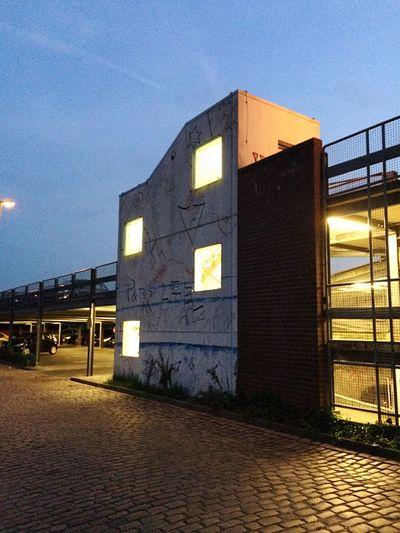 Illuminated building against clear sky