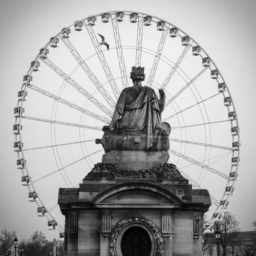 Statue Against Ferris Wheel At Place De La Concorde