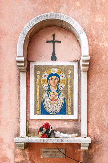 Ave Maria painted on miniature tiles on a wall, Venice, Italy Ave MARIA Cross Venice Italy Arch Architecture Built Structure Close-up Day Flower Human Representation No People Outdoors Place Of Worship Religion Spirituality Stone Frame Tiled Art Tiled Painting Wall Art ♥ Window Frame