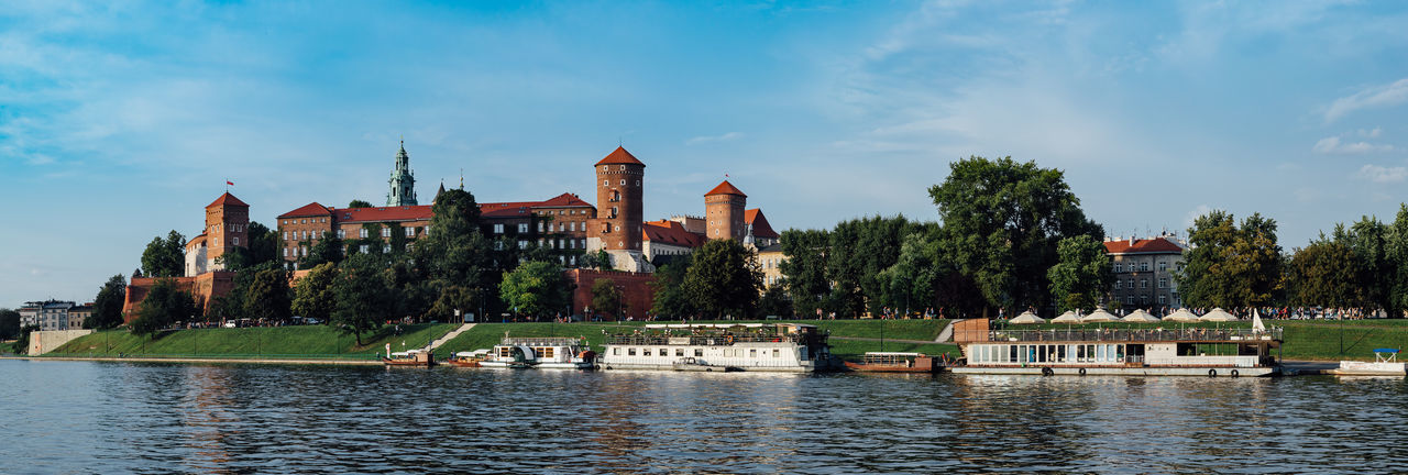 Panoramic view of he wawel castle in krakow, poland, in the foreground the vistula river.