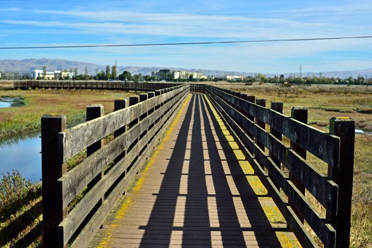 Bridge over landscape against sky