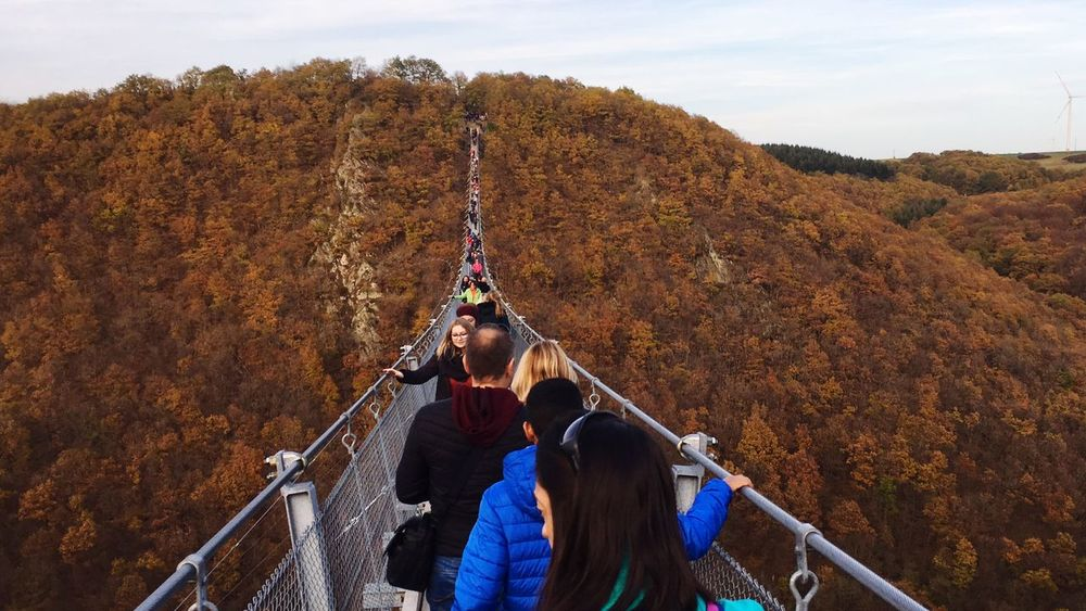 Crossing the bridge EyeEmNewHere Architecture Bridge - Man Made Structure Women Adult Nature Rear View Leisure Activity People Togetherness Autumn Emotion Day Young Women Railing Young Adult Outdoors Beauty In Nature