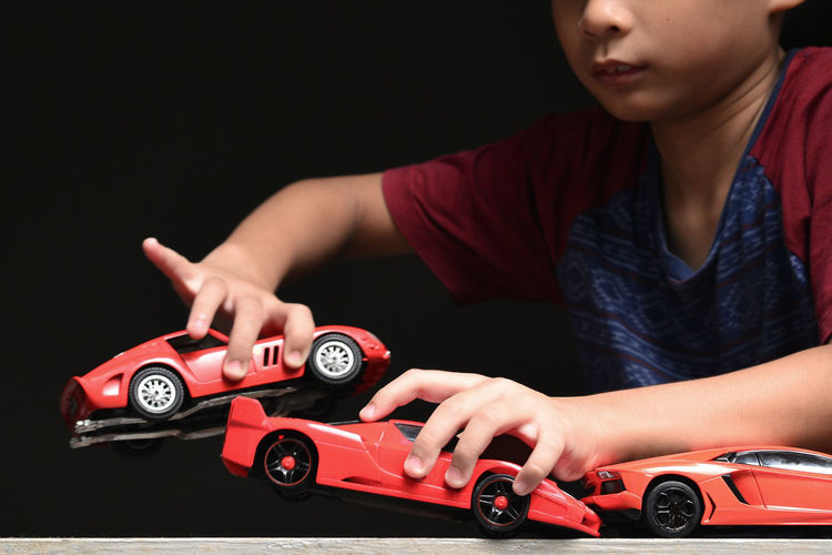 Playing With Toy Car Dream Cars Toys Aspiration Black Background Boy Will Be Boys Collection Indoors  Italian One Person Red Red Cars Sports Car Studio Shot Motor Vehicle