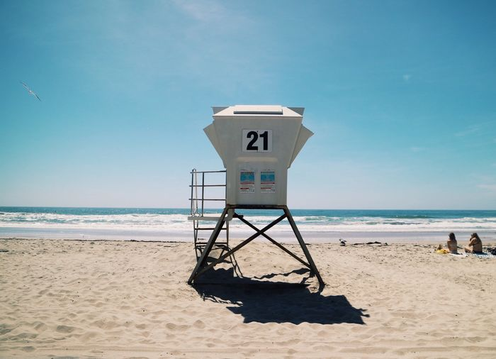 Beach Sea Sand Water Horizon Over Water Lifeguard Hut Number Shore Safety Nature Day Tranquility Protection Scenics Sky Tranquil Scene Beauty In Nature Sunlight Outdoors