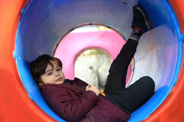Portrait of boy sitting in playground