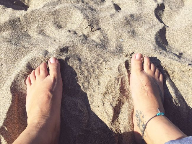 Bare feet in the sand. Tattoos rule Tattoos EyeEm Selects Feet Sand Beach Barefoot Real People Low Section High Angle View Personal Perspective Outdoors Relaxing Anklet This Is My Skin Human Body Part Human Foot Lifestyles