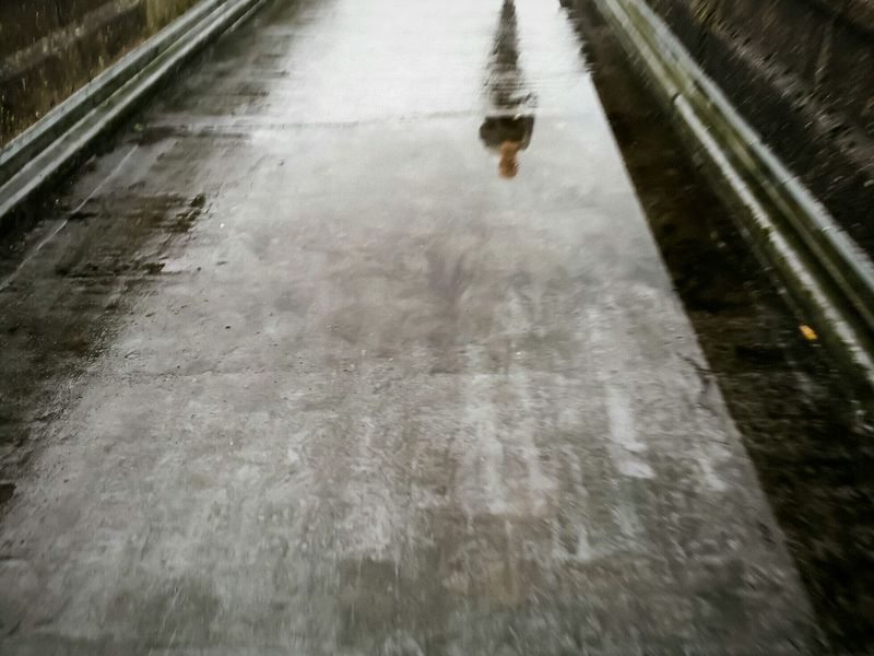 Never mind the weather The Following Nature's Diversities Rain Blurry Girl PowerPath Bridge Textures And Surfaces Sheen Wet The Great Outdoors - 2016 EyeEm Awards Landscape Portrait Glow Metallic Shiny Reflection Glare On The Water Glare Puddleography Puddle Pavement Road Walking Around Abstract