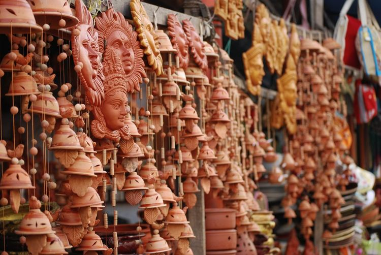 Close-Up Of Clay Handicrafts For Sale At Market Stall