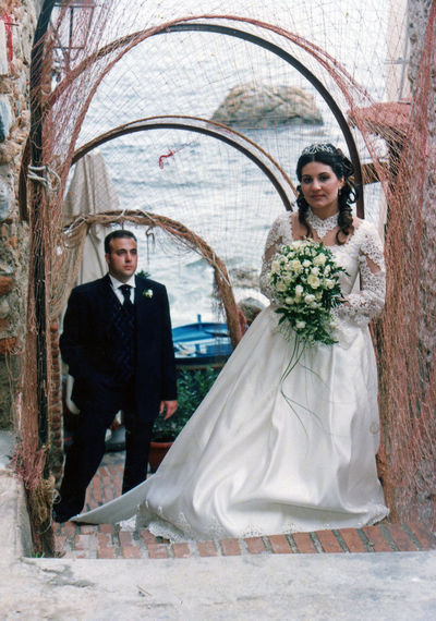 Young bride and groom standing on doorway