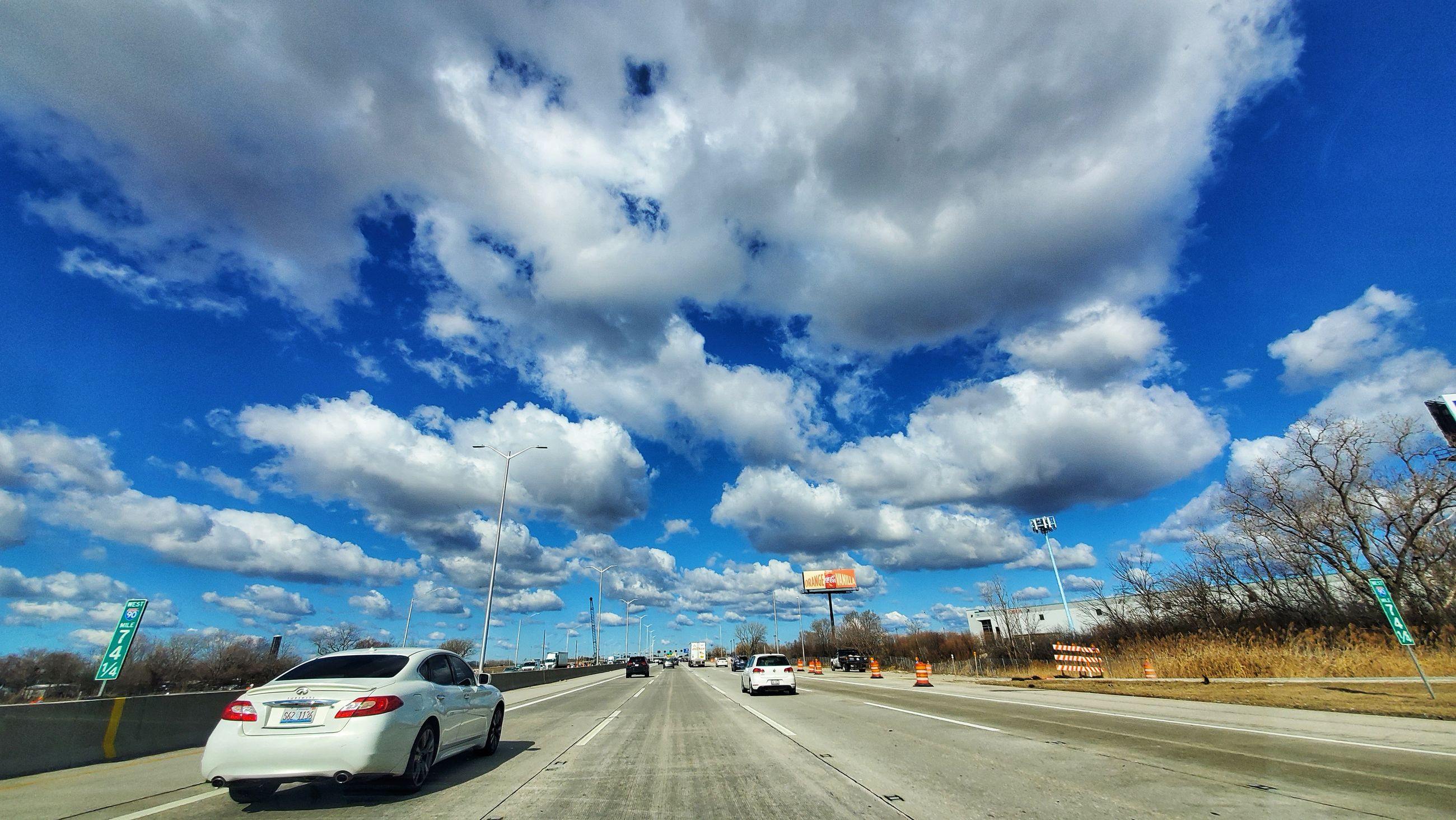 cloud - sky, sky, transportation, road, mode of transportation, car, motor vehicle, land vehicle, the way forward, day, nature, blue, direction, no people, on the move, city, street, motion, travel, outdoors, road trip