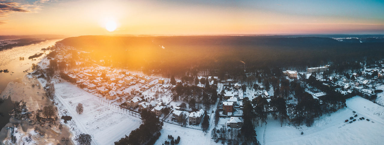 Panoramic view of frozen landscape against sky during sunset