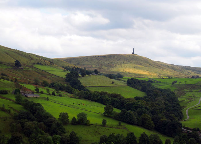 stoodley pike in landscape Stoodley Pike Beauty In Nature Cloud - Sky Day Field Grass Green Color Hill Landscape Nature No People Outdoors Scenics Sky Slope Tranquil Scene Tranquility