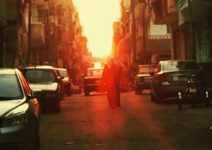 Sunset in ismailia - sunset in a rural scene reflects the feeling of exhaust after a long day Sunset Ismailia Egypt Exhaust Cars Light Rays Manwalk Arab Tired Steetphotography Carpark Streetparking First Eyeem Photo