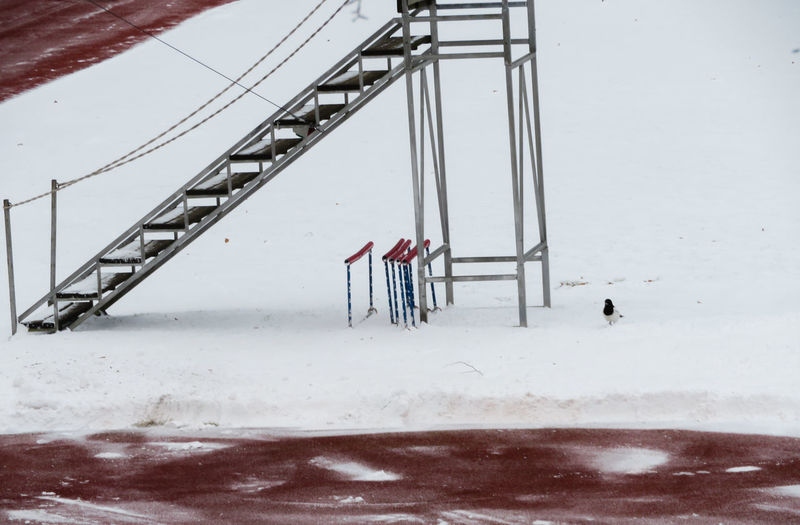 stadium in snow Outdoors Nature Track And Field Stadium White Snow Sky Snowfall Snow Covered Cold Temperature Cold Weather Condition Covering