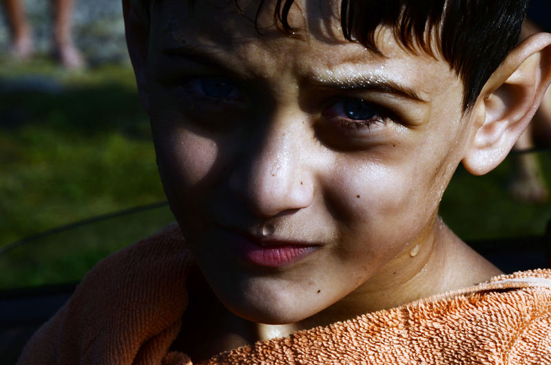 A boy from the border village Akhal Abastumani, after bathing in the River of Enguri (village is situated near so called border with Abkhazia - conflict region in Georgia). Blue Eyes Close-up EyeEm EyeEm Portraits Focus On Foreground Front View Headshot Human Face One Person Outdoors Portrait Portrait Photography Potrait Real People Sunny Day Tamar Mirianashvili Water Drops Week On Eyeem Young Adult The Portraitist - 2017 EyeEm Awards