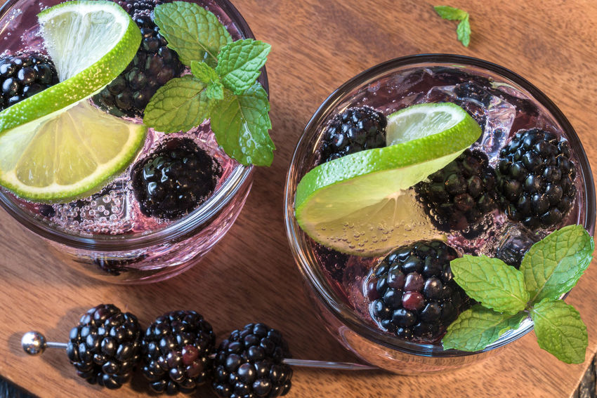 Blackberry mojito Adult Adults Only Berry Beverage Blackberry Cheers Close Up Cocktail Directly Above Drink Green Isolated Libation Lime Mint Mojito Purple Top View