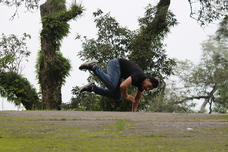 Man playing on tree