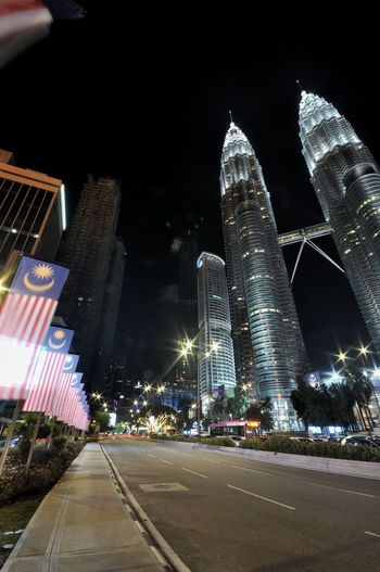 ♥MALAYSIA Kuala Lumpur KLCC Twin Towers Klcc Twins Twin Towers Tallest Building Malaysia Kl Flag Jalur Gemilang Merdeka Independence Day Blurry Road Streetphotography Nightphotography Night Construction City Illuminated Cityscape Skyscraper Urban Skyline Modern Sky Architecture Building Exterior Light Trail High Street Long Exposure