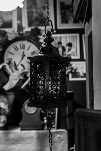 Close-up of lantern hanging on table at home