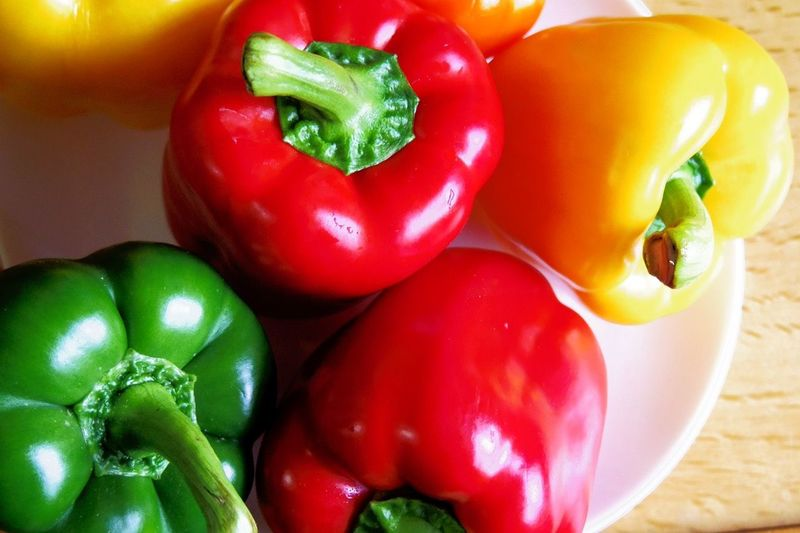 Close-up of bell peppers in plate on table