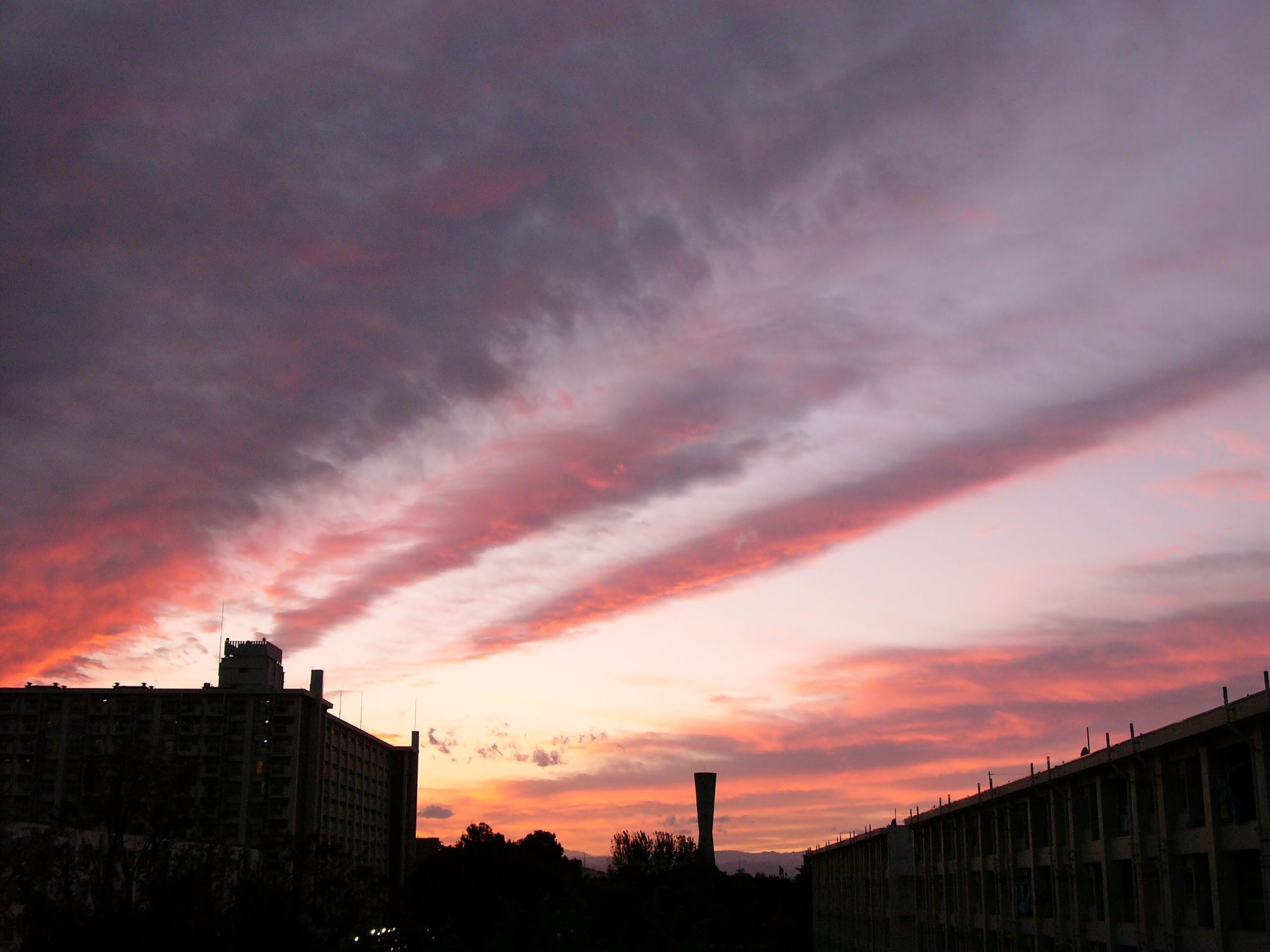 cloud - sky, architecture, building exterior, sunset, built structure, dramatic sky, sky, city, silhouette, no people, beauty in nature, outdoors, nature, cityscape