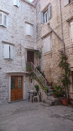 Taking Photos Trogir Stone Steps Holiday Memories Stone - Object Stone Wall Architecture Urbanphotography Windows_aroundtheworld Windows Dalmatia Exterior Design Exterior Old Doors The Architect The Street Photographer - 2016 EyeEm Awards