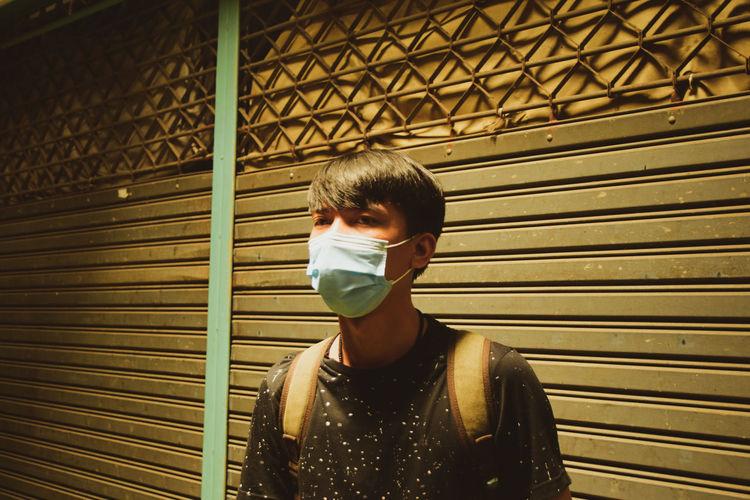 Asian men wearing masks