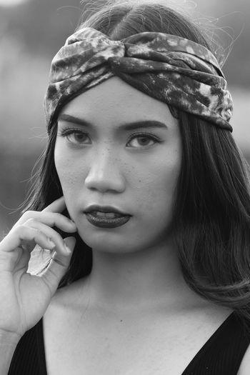 Close-up portrait of beautiful young woman wearing bandana
