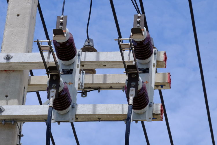 Low Angle View Day Nature Sky No People Outdoors Metal Technology Blue Industry Connection Machinery Transportation Cloud - Sky Wood - Material Pulley Hanging Cable Sunlight Construction Industry Directly Below