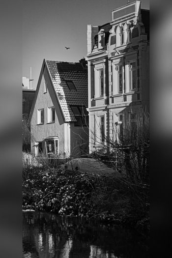 Heimat in S/W House, Black And White, Architecture, Building Exterior, Residential Building, Built Structure, Window, Old, Outdoors, No People, Old-fashioned, Facade, Residential District, History, Home Ownership, Monochrome, Architecture And Buildings, Everypixel Architecture Building Exterior Built Structure Day House No People Outdoors Sky Water