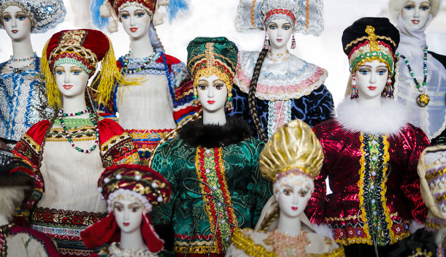Close-up of typical dolls wearing colorful traditional clothes