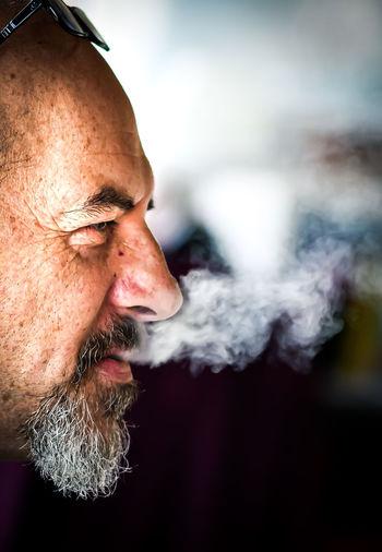 Man smoking cigarette outdoors