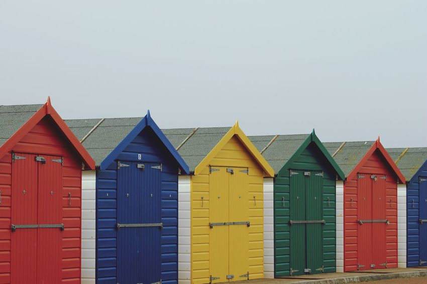 Beach huts Brightly Coloured Painted Huts EyeEm Selects Built Structure Architecture Building Exterior No People Sky Beach Hut Side By Side Hut Building Multi Colored Beach Outdoors In A Row