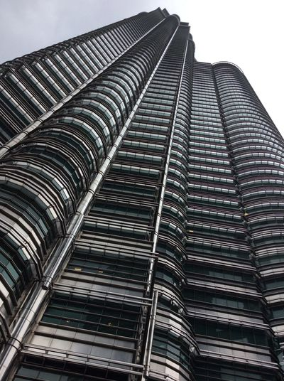 Petronas Twin Towers Dec Grey Morning tall skyscraper Business Building Kuala Lumpur Malaysia  Steel Structure  Contemporary Architecture Grey Sky