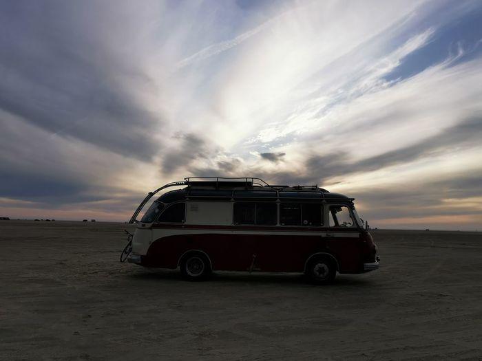 Vintage car on road during sunset