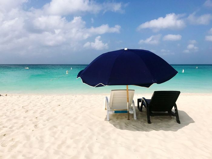 Aruba Caribbean Sea Beach Sand Horizon Over Water Sky Nature Water Shore Beauty In Nature Scenics Tranquil Scene Summer Chair Tranquility Day Vacations Cloud - Sky No People Outdoors