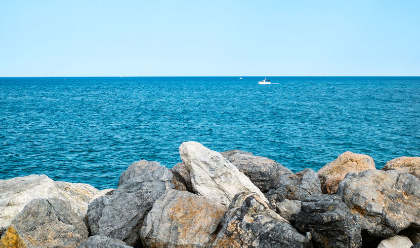 pleasure boats at sea Pleasure Boats At Sea Pleasure Boat Rocks Mediterranean Sea Sea Water Horizon Horizon Over Water Sky Rock Rock - Object Scenics - Nature Beauty In Nature Solid Blue Clear Sky Tranquil Scene Tranquility Nature Day No People Copy Space Idyllic Outdoors My Best Photo