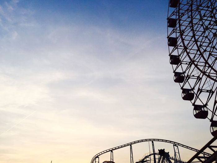 Amusement Park Arts Culture And Entertainment Low Angle View Ferris Wheel Amusement Park Ride Rollercoaster Big Wheel Outdoors Sky Built Structure Day No People
