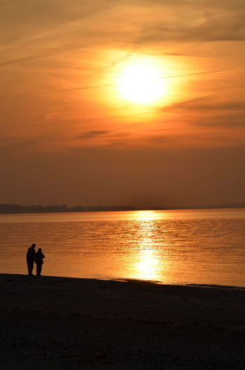 Love Couple Two Person At The Beach Sunset Sea Silhouette Beach Sun Horizon Over Water Water Beauty In Nature Tranquil Scene Nature Real People People Adult Golden Moment Golden Hour Golden Sunset Golden Light Leisure Activity Adults Only Outdoors Sand Scenics Sky