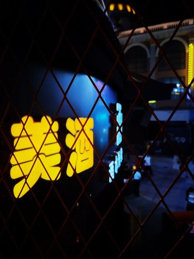 Yellow seen through chainlink fence