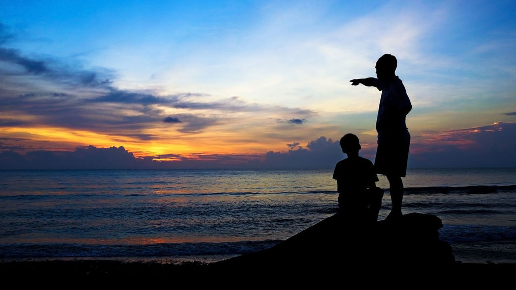Father and son silhouettes on a sunset beach Adolescence  Advice Beach Sunrise Beach Sunset Boy Dreams Family Father Father & Son Father And Son Fatherly Hope Horizon Life Lesson Life Lessons Man Manhood Parenting Pointing Silhouette Silhouettes Sunrise Sunset Teaching Wisdom