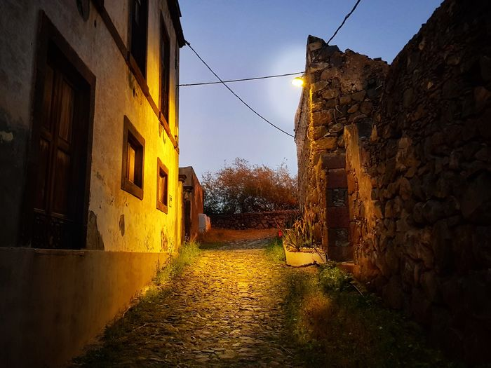 Light fighting darkness Light Light And Shadow Rustic Old Buildings Cosy Cosy Place Yellow Sky Building Exterior Building Exterior Alley Cobblestone Narrow Passageway