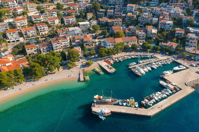Aerial view of brela town below biokovo mountain, the adriatic sea, croatia