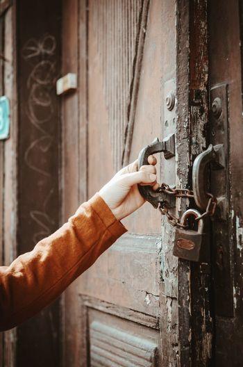 Close-Up Of Hand Holding Door Handle