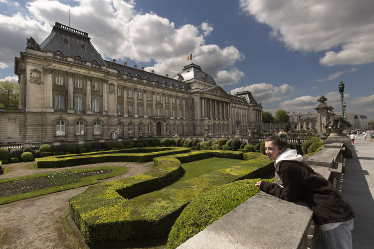Teenager next to the royal palace with its gardens in Brussels capital of Belgium. Belgique Brussels Travel Travel Photography Architecture Building Exterior Built Structure City Cloud - Sky Day History Leisure Activity Lifestyles Monument One Person Outdoors People Real People Royal Palace Brussels Side View Sky The Past Travel Destination Travel Destinations Well-dressed