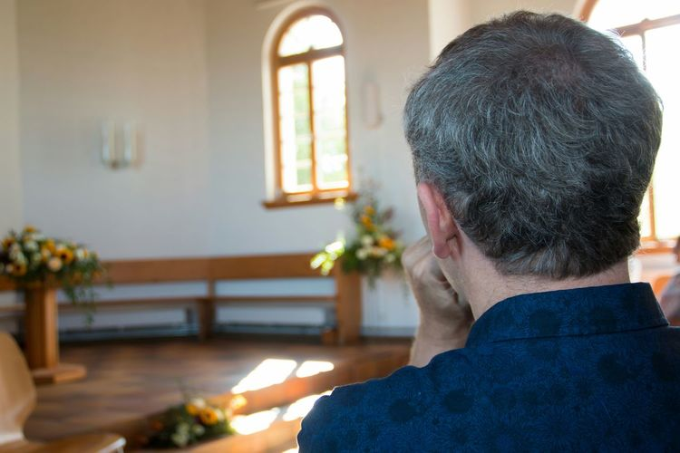 Rear view of man sitting at church