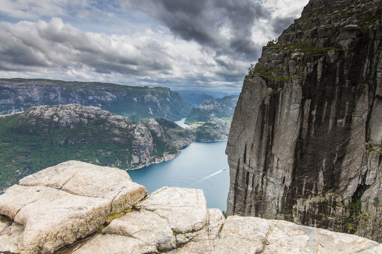High angle view on fjord against sky and mountains Lysefjord Norway Preikestolen Beauty In Nature Cloud - Sky Day Environment Fjord Formation Land Landscape Mountain Nature No People Non-urban Scene Outdoors Rock Rock - Object Rock Formation Scenics - Nature Sky Solid Tranquil Scene Tranquility Water